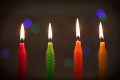 Colorful candles on dark background Royalty Free Stock Photography