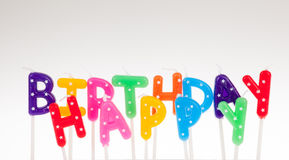 Colorful candles in letters saying Happy Birthday Stock Images
