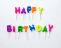Colorful candles in letters saying Happy Birthday. Stock Photography