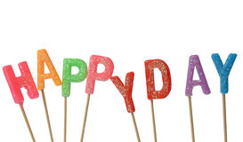 Colorful candles in letters saying Happy day, isolated on white background Stock Photo