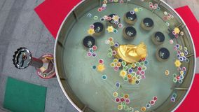 Colorful Candles in Lotus Shape Floating on Water in a Buddhist Temple. Thailand. Colorful candles in lotus shape floating on water in a Buddhist temple stock video footage