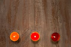 Colorful candles on the wooden boards. royalty free stock image