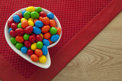 Colorful candy. In an elegant bowl on the table Stock Photos