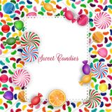 Colorful candy background with jelly beans, lolipop and orange slice Royalty Free Stock Photo