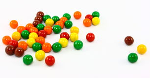 Colorful Candy Balls. Tiny colorful candy coated chocolate balls on a white background Stock Images