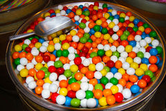 Colorful Candy Balls in Bin with Scoop Royalty Free Stock Image