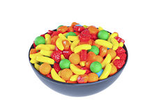 Colorful candy in a black bowl, isolated on white background. Fruits shapes Stock Photos