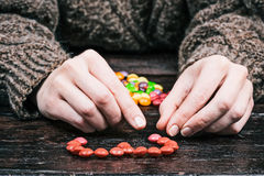 Colorful candy buttons and hands Stock Images