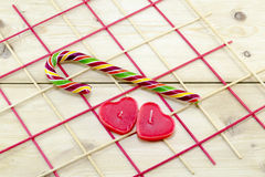 Colorful candy cane and heart shaped candles Stock Images