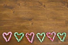 Colorful candy canes arranged in heart-shapes Stock Photography