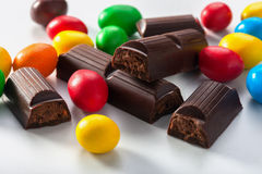 Colorful candy and chocolate bars. In disarray Stock Photos