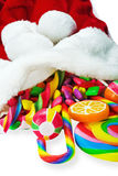 Colorful candy in a Christmas sock Royalty Free Stock Photo