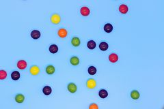 Colorful candy closeup on a blue background, sweet background. Food royalty free stock image