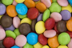 Colorful candy coated chocolate sweets Stock Photos