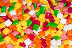 Colorful candy coated gum squares. Texture and pattern background royalty free stock photo