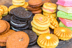 Colorful candy cookies cream. On a wooden table Royalty Free Stock Photo