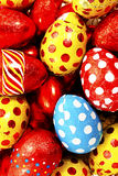 Colorful candy Easter eggs wrapped in foil Royalty Free Stock Images