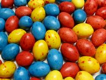 Colorful candy eggs. Close-up of a bunch of candy eggs, focused on some Royalty Free Stock Photography