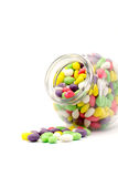 Colorful candy in glass bottles isolated isolated Stock Photography