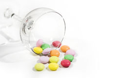 Colorful candy in a glass. Macro focus and blur back ground on white paper royalty free stock photo