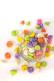 Colorful candy in glass saucer and bowl isolated on white backgr Stock Images