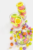 Colorful candy in glass saucer and bowl isolated on white backgr Royalty Free Stock Photos