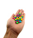 Colorful candy in hand Royalty Free Stock Images