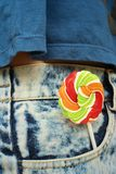 Colorful of candy in a jeans pocket. Stock Photos