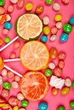 Colorful candy, jelly, lollipop on stick, scattering of multicolored sweets royalty free stock image