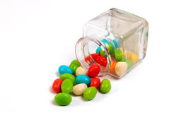 Colorful candy in a little bottle. Stock Photos
