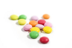 Colorful candy macro focus. And blur back ground on white paper stock photo