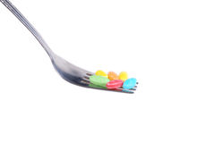 Colorful candy with  metal fork Royalty Free Stock Images