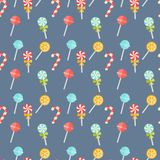 Colorful candy seamless pattern. Colorful candy seamless background pattern on blue with festive candy canes. lollipops and orange suckers in square format for Royalty Free Stock Photography