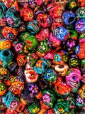 Colorful Candy Skulls for Day of the Dead in Mexico. Plaster skulls are painted brightly in a rainbow of colors at a Mexican Market in CDMX Mexico City stock photography