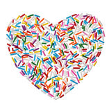 Colorful candy sprinkles heart isolated on white background Stock Photography