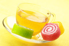 Colorful candy and tea Royalty Free Stock Photography
