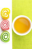 Colorful candy and tea Royalty Free Stock Photo