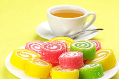Colorful candy and tea Stock Photos