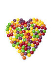 Colorful candy on white background in heart shape Royalty Free Stock Photo