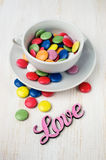 Colorful candy in a white cup Royalty Free Stock Image