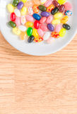 Colorful candy in white plate Stock Images