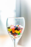 Colorful candy in Wine Glass Royalty Free Stock Image