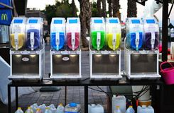 Colorful canisters of refreshing cold slushy ice drinks in old city market of Tiberias, Galilee, Israel stock photo