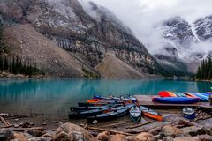 Canoe at Moraine lake in the morning stock image