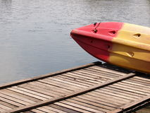 Colorful canoe an a lake bank Stock Image