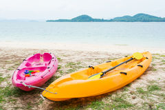 Colorful canoe at the tropical beach Stock Photo