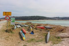 Colorful canoeing or kayak boats parked on the river Mirna in Istria, Croatia. Colorful canoeing or kayak boats parked on the river Mirna in Antenal, Istria royalty free stock images