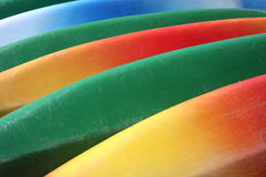 Colorful canoes. Red, yellow, green and blue canoes Royalty Free Stock Images