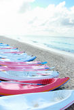 Colorful canoes in the beach Royalty Free Stock Photos