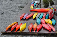 Colorful canoes on dock Royalty Free Stock Photography